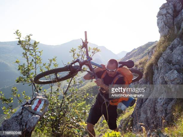 mountain biker riding in the mountains. - endurance race stock pictures, royalty-free photos & images