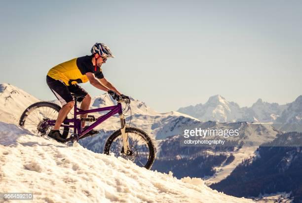 Mountain biker riding on the snow