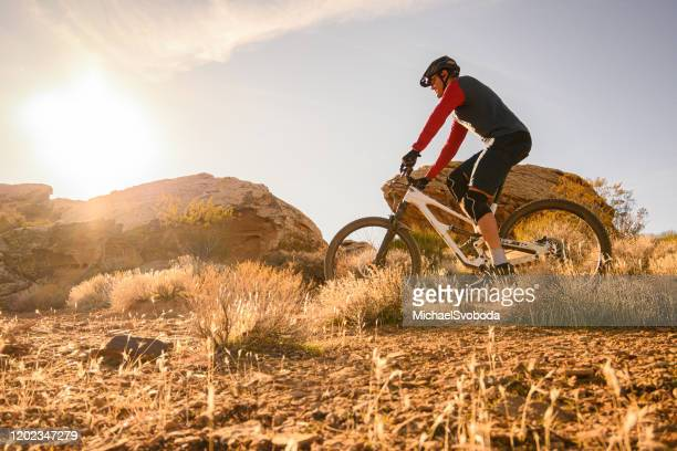 mountain biker riding the southwest desert - st. george utah stock pictures, royalty-free photos & images