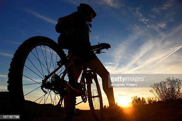 mountain biker sunset silhouette - moab utah stock photos and pictures