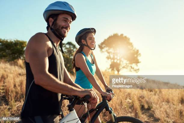 mountain bikers breathe in fresh air, not pollution - outdoor pursuit stock pictures, royalty-free photos & images