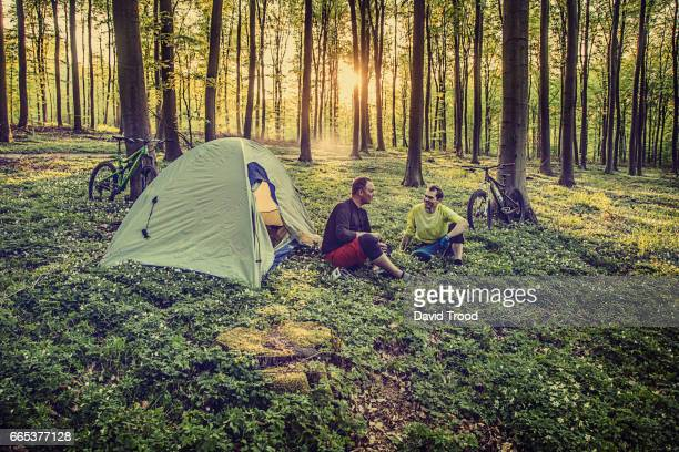 Mountain bikers camping in the forest