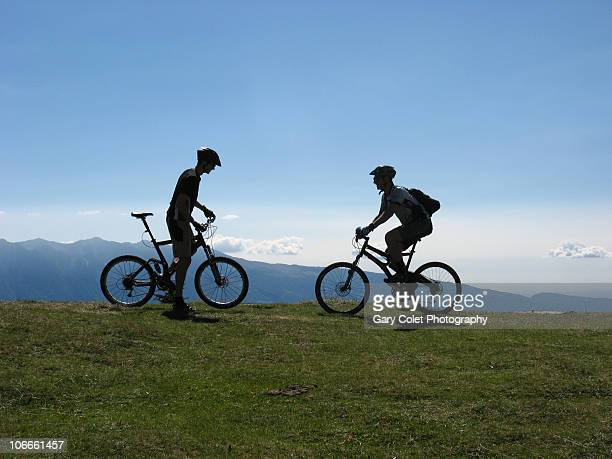 mountain bikers in silhouette - gary colet stock pictures, royalty-free photos & images