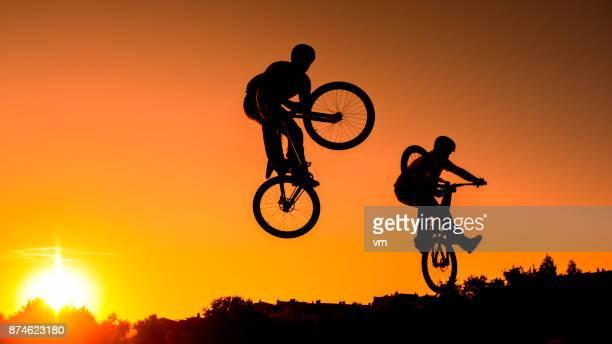 Mountain bikers jumping