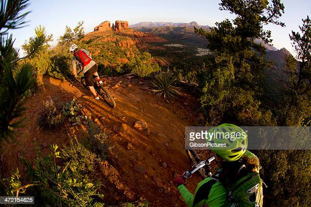 mountain bikers on a dirt trail in sedona, arizona - sedona stock photos and pictures