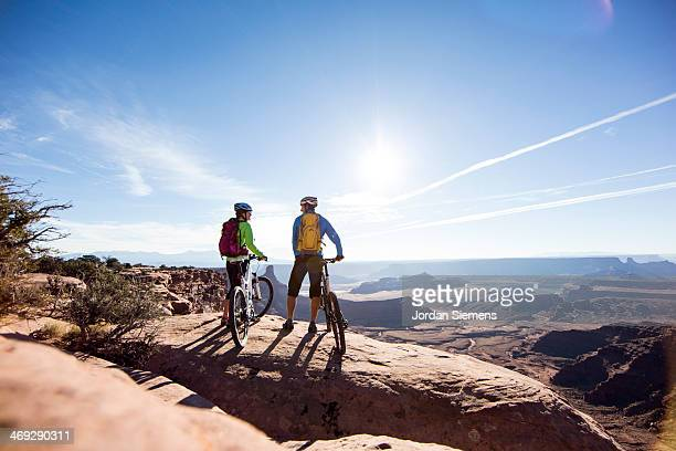 Mountain bikers on top of a cliff
