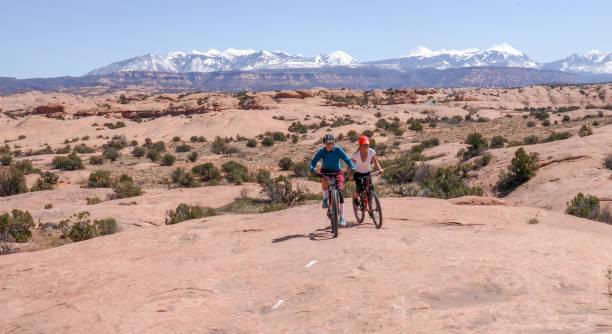 Mountain bikers race across top of slab along marked trail
