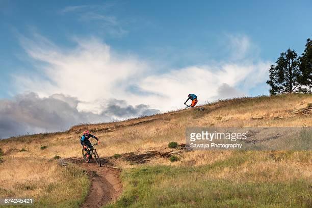 Mountain bikers ride along Columbia River.