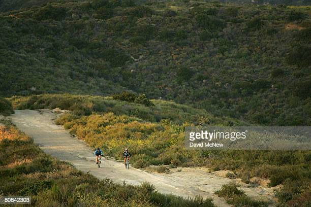 Mountain bikers ride in Laguna Coast Wilderness Park, part of a nearly 40,000-acre swath of Orange County open space that has been designated as the...