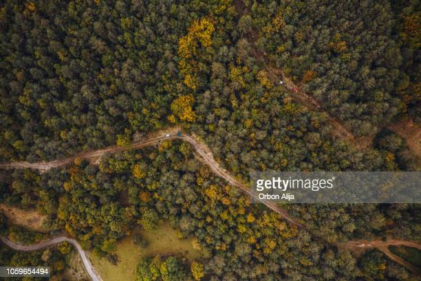 mountain bikers riding on a road. aerial view photography - mountain bike stock pictures, royalty-free photos & images
