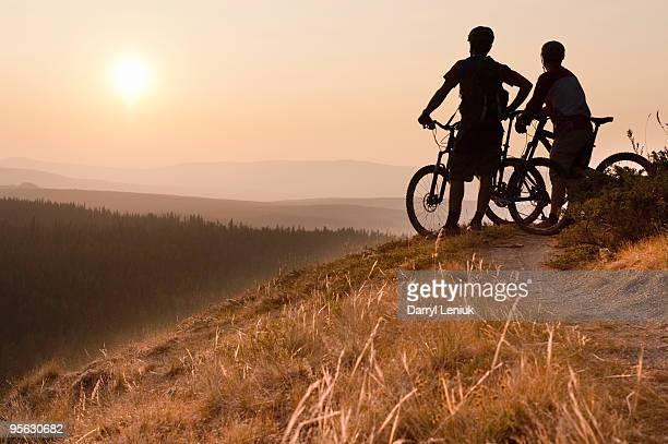 mountain bikers taking break