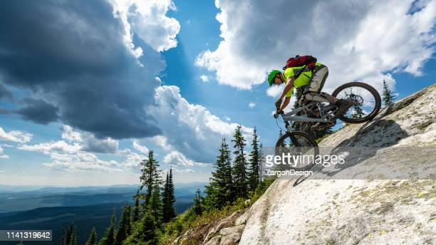 mountain biking at ski resort - mountain biking stock pictures, royalty-free photos & images