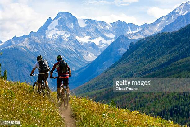 mountain biking british columbia - cycling stock pictures, royalty-free photos & images