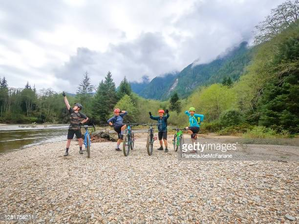 mountain biking, family and friends posing with balancing bikes - vancouver canada stock pictures, royalty-free photos & images