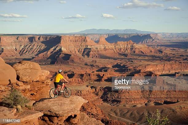 mountain biking in canyonlands national park, moab, utah - moab utah stock photos and pictures