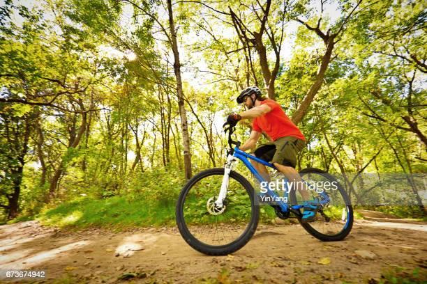 Mountain Biking in Wooded Biking Trail