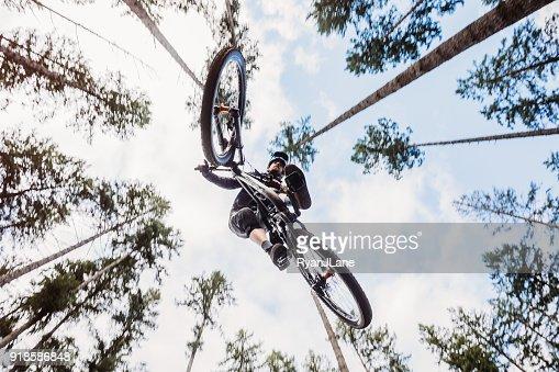 Mountain Biking Man Gets Big Air off Jump