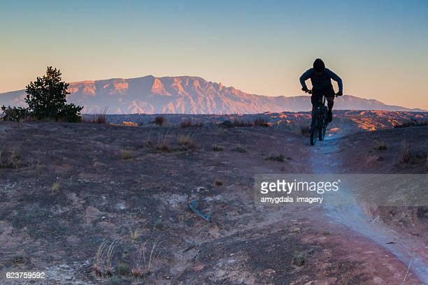 mountain biking man landscape - sandia mountains stock photos and pictures