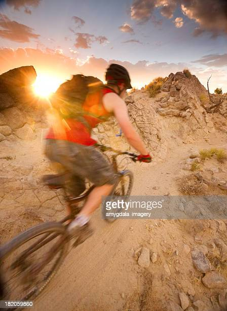 mountain biking motion sunset - western juniper tree stock pictures, royalty-free photos & images
