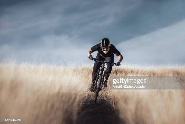 mountain biking on trail. - downhill skiing stock pictures, royalty-free photos & images