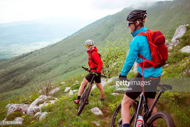 mountain biking - cross country cycling stock pictures, royalty-free photos & images