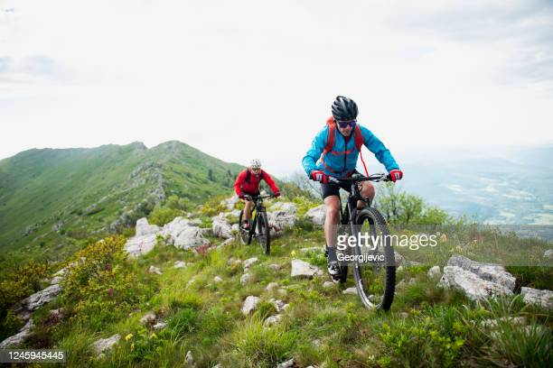 mountain biking - georgijevic mountain biker stock pictures, royalty-free photos & images
