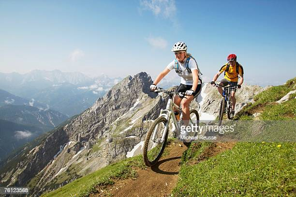 German Alps, Karwendel, young couple mountain biking