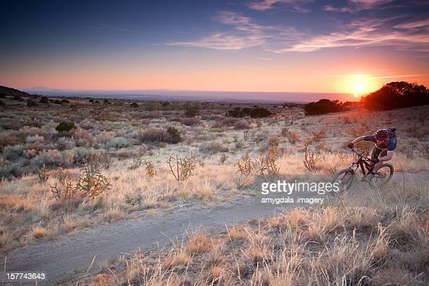 mountain biking sunset landscape - sandia mountains stock photos and pictures