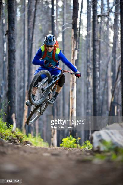 mountain biking through the forest fire burn - cross country cycling stock pictures, royalty-free photos & images