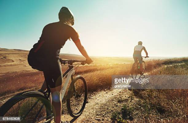 mountain biking will bring you a great deal of fun - cross country cycling stock pictures, royalty-free photos & images
