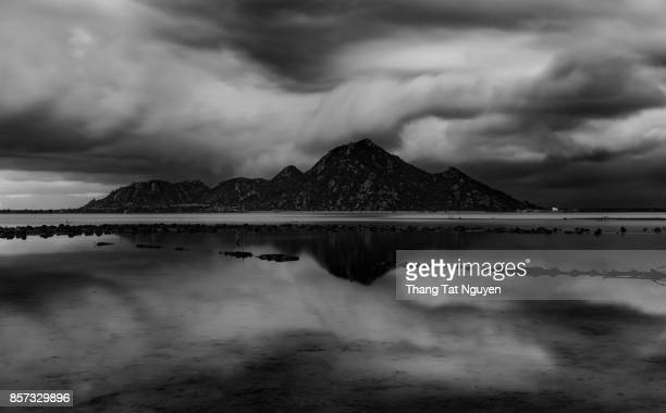 Mountain by lake in front of storm