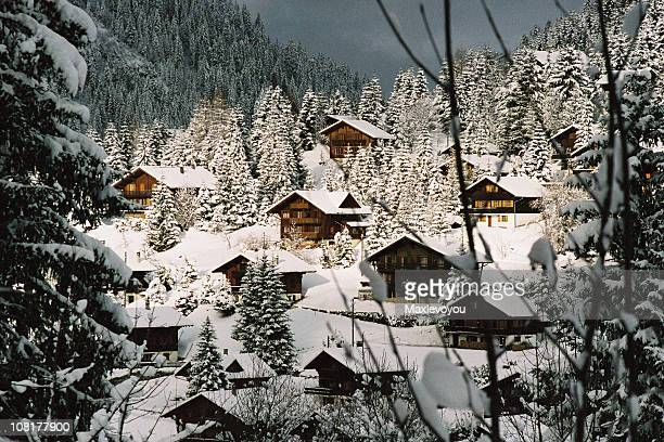 Mountain Chalets Covered in Snow