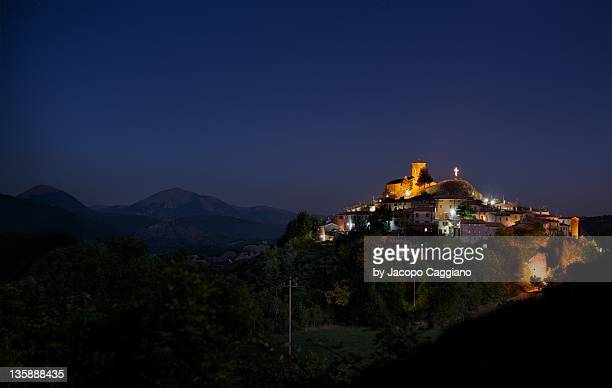 mountain city in the night - jacopo caggiano stock pictures, royalty-free photos & images