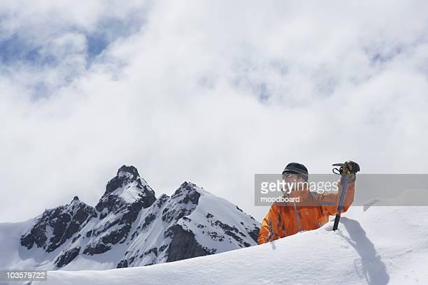 Mountain climber coming over peak