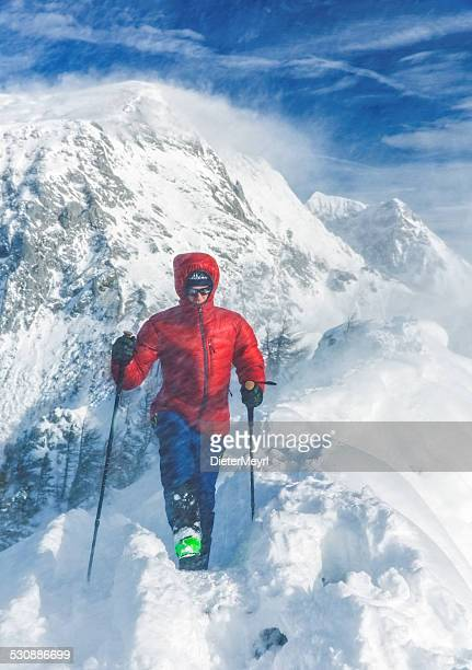 Mountain climber in snow storm