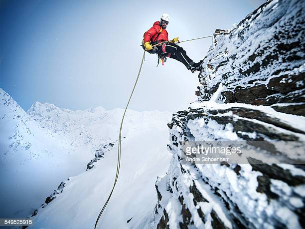 mountain climber in the austrian alps - klettern stock-fotos und bilder