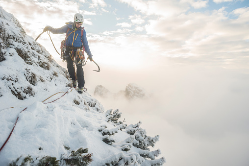 Mountain climber in winter in Tatra Mountains, Malopolskie Province, Poland - gettyimageskorea