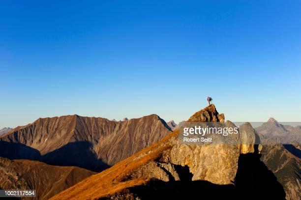 Mountain climber on a peak, Namlos, Lechtal, Reutte, Tyrol, Austria