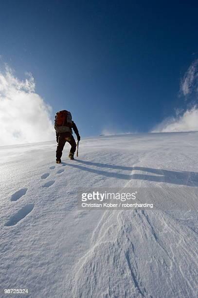 Mountain climber on snow covered Mount Fuji, Shizuoka Prefecture, Japan, Asia