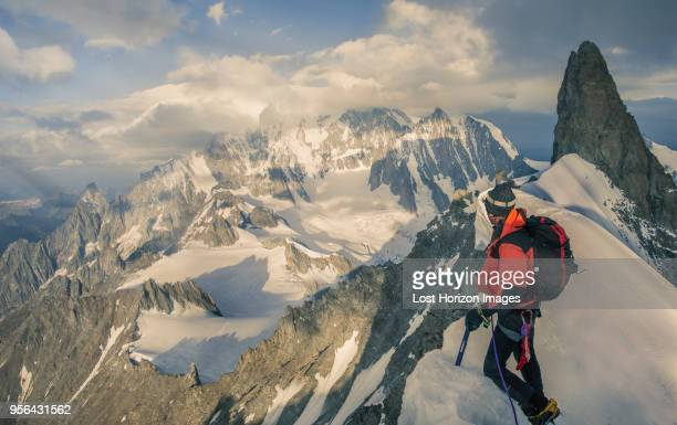 Mountain climber on the Rochefort Ridge looking at Mont Blanc, Courmayeur, Aosta Valley, Italy, Europe