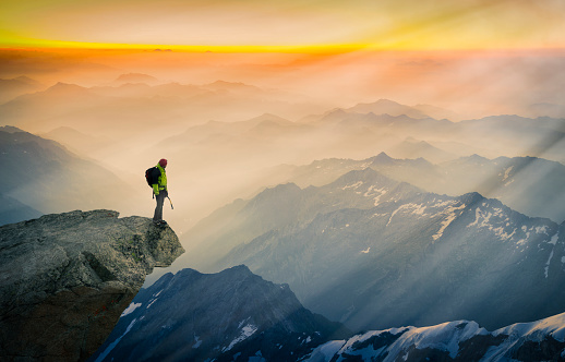 Mountain climber standing on edge of mountain, looking at view, Courmayeur, Aosta Valley, Italy, Europe - gettyimageskorea
