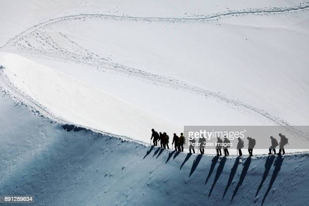 mountain climbers in the mont blanc massif - mountaineering stock pictures, royalty-free photos & images