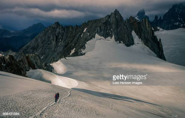 Mountain climbers on the Mer de Glace glacier, in the Mont Blanc Massif, Courmayeur, Aosta Valley, Italy, Europe