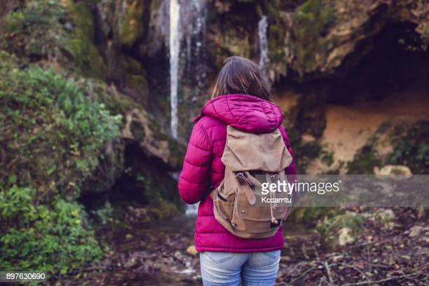 mountain climbing - behind waterfall stock pictures, royalty-free photos & images