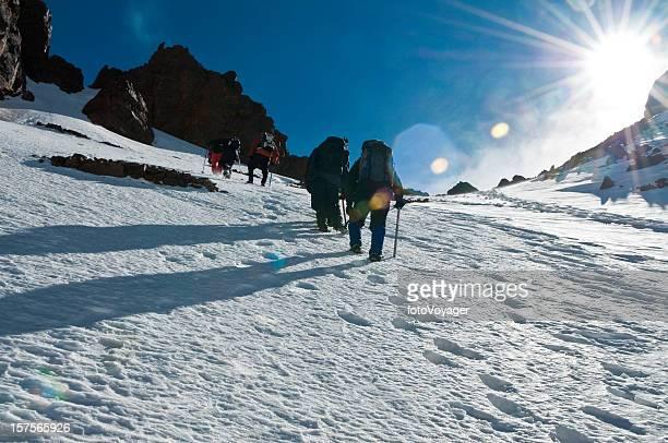 Mountain climbing snow summit sunburst high altitude mountaineering adventure