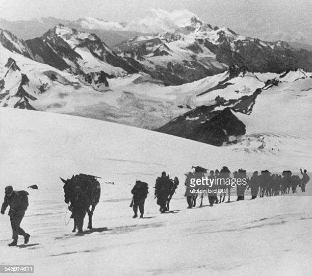 Mountain Division of the German Wehrmacht mountain infantry at Caucasus pack horses crew carry parts of a mountain gun to the next base
