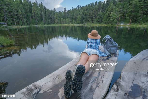 mountain girl enjoying freedom in nature - lake bottom stock photos and pictures