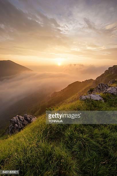 Mountain Grona's summit with sunrise