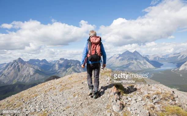 mountain hiker carries ipad up ridge crest - kananaskis country stock pictures, royalty-free photos & images