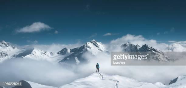 mountain hiker - berg stock-fotos und bilder